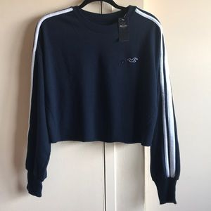 A long sleeve slightly cropped sweater